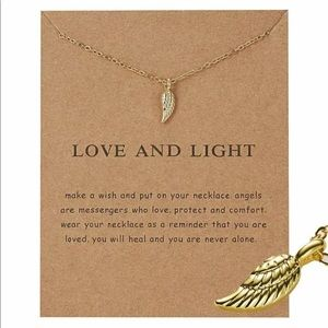 Great gold tone wing necklace, stocking stuffer